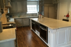 Custom kitchen island with built in ovens