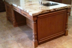 Custom kitchen cabinets with marbled granite counter tops.
